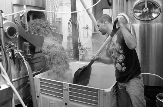 The used mash is gathered in big 369 kilogram bins and shipped to a farm in Aldergrove where it's used for feed.
