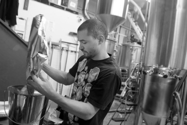 Wong weighs Perle hop pellets that will be added to one of the 1,700 litre brewhouse tanks.