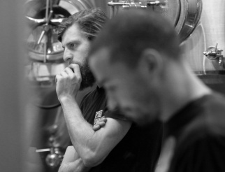 Brewmaster Peter Schulz ponders the day's batch of red pilsner.