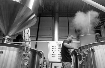 Wong checks the progress of the beer brewing in one of two 1,700 litre brewhouse tanks.