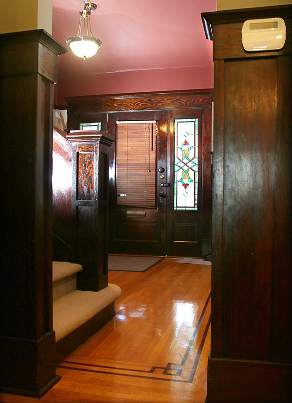 Photo by Mario Bartel The front entrance features the original fir wood panels as well as leaded glass windows.