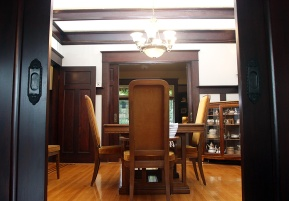 Photo by Mario Bartel The dining room is separated from the front parlour and kitchen by wood pocket doors.