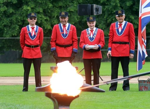 Members of the Battery look on as the first of 21 shots is ignited by sparking gunpowder between two heavy iron anvils. The unique ceremony originated in the 1870s when the Hyack Fire Company didn't have a cannon available to fire a salute to Queen Victoria on her birthday. One of the members, a former Royal Engineer, recalled once seeing gunpowder and the anvils being used to create a blast. Photo by Mario Bartel