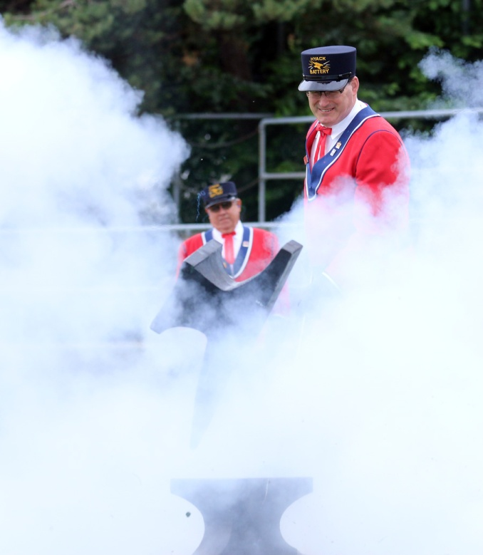 """Jerry Dobrovolny, the Hyack Anvil Battery's """"medical officer,"""" alights the anvils. Photo by Mario Bartel"""