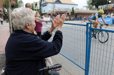 MARIO BARTEL PHOTO Doreen Speers cheers on the riders in the women's race at Friday's PoCo Grand Prix.