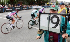 """MARIO BARTEL PHOTO Heidi Ujfalusi rings the bell to signal a """"Prime"""" lap in which riders race to the finish line to claim a cash prize."""