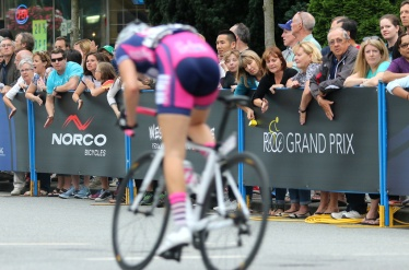 MARIO BARTEL PHOTO Spectators along the barriers on Shaugnessy Street cheer on the riders in the women's race at Friday's PoCo Grand Prix.