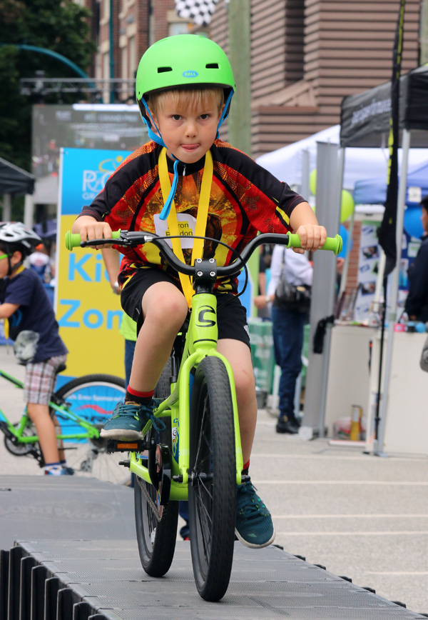 MARIO BARTEL PHOTO Aaron Paddon, 6, concentrates as he negotiates the trials course in the Kids Zone at Friday's PoCo Grand Prix.