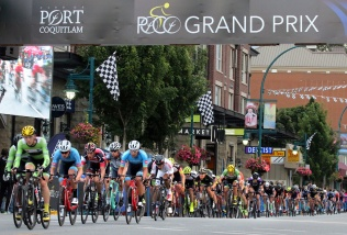 MARIO BARTEL PHOTO The men's peloton is strung along Shaugnessy Street.