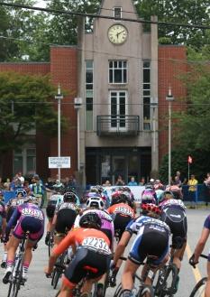 MARIO BARTEL PHOTO The women's peloton speeds along McAllister Avenue towards the PoCo Court House in Friday's PoCo Grand Prix.