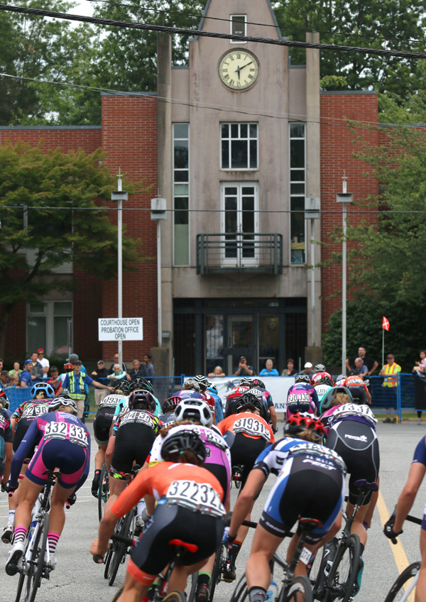MARIO BARTEL PHOTO The women's peloton speeds along McAllister Avenue towards the PoCo Court House in Friday's PoCo Grand Prix.
