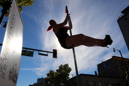 PHOTO BY MARIO BARTEL A pole dancer from AVA Fitness gets some height at Saturday's Pride street party.