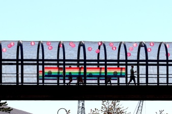 PHOTO BY MARIO BARTEL The pedestrian bridge at Hyack Square is appropriately decorated for Saturday's Pride street party.