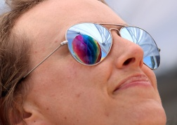 PHOTO BY MARIO BARTEL A rainbow decoration is reflected in the sunglasses of Vanessa Galt at Saturday's Pride street party on Columbia Street.