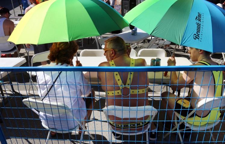 PHOTO BY MARIO BARTEL Umbrellas were a necessary accessory in the beer garden at Saturday's Pride street party on Columbia Street.