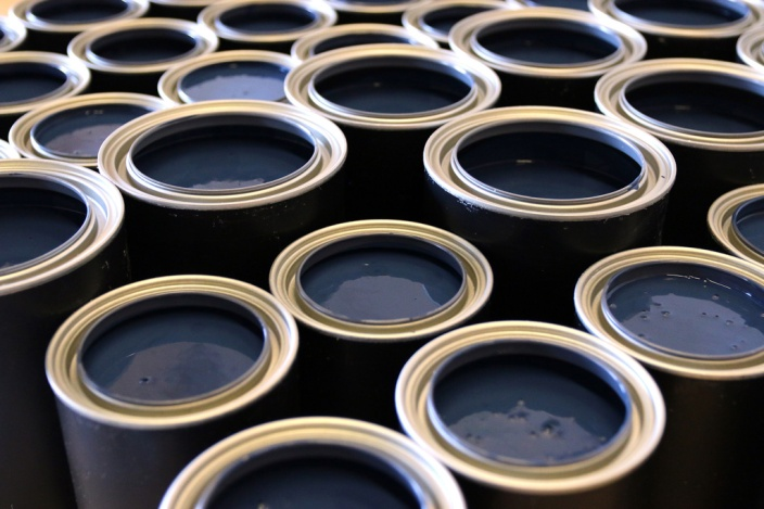 PHOTO BY MARIO BARTEL Fresh cans of FAT Paint await lids.