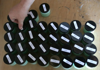 PHOTO BY MARIO BARTEL Labels are affixed to sample jars of FAT Paint.