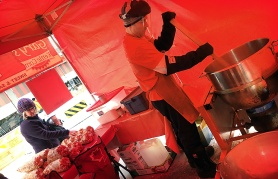 A t-shirt is all Jason needs to stay warm as he works the giant kettle at Garry's Kettle Corn.