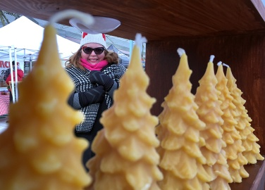 Amanda tries to stay warm at ther Honey Bee Zen kiosk.