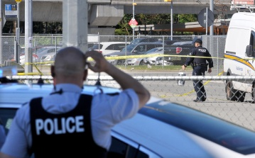 A report of a suspicious package in the parking lot at Coquitlam Station was certainly puzzling, so all I had to do was wait for the cop in the foreground to scratch his head at the right time.