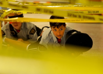 Determination is all in the eyes, and this young junior Mountie was certainly keen on navigating the police tape challenge.