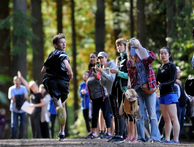 Fall light is beautiful. The kid looking back at his competitors is just a happy accident because I orinally lined up this photo to take advantage of the backlight through the trees and spectators along the cross-country course in Mundy Park.