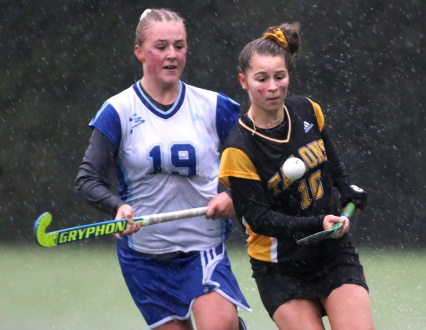 Even in a driving deluge, Jenna Buglioni was able to juggle the field hockey ball around her opponents. It took me two days to dry out after shooting this game.