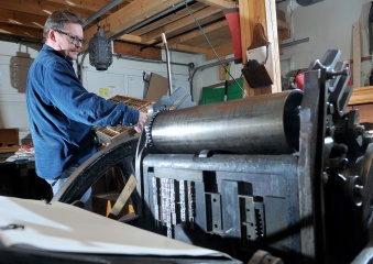 MARIO BARTEL/THE TRI-CITY NEWS Graphic artist Markus Fahrner sorts through blocks of lead type he uses to print pages and posters in an old Colt Armoury letterpress that once belonged to world-renowned typographer Jim Rimmer of New Westminster.