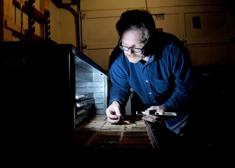 MARIO BARTEL/THE TRI-CITY NEWS Markus Fahrner sorts through blocks of metal fonts he uses to create books and posters on his 1914 printing press in the garage of his Port Moody home.