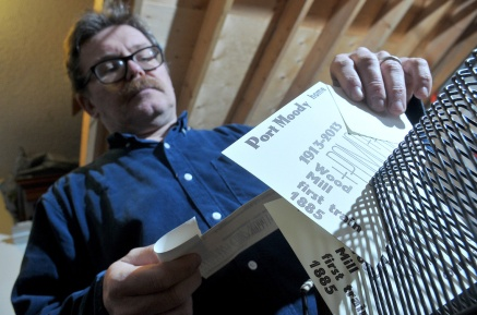 MARIO BARTEL/THE TRI-CITY NEWS Port Moody graphic artist Markus Fahrner places cards freshly printed on his 1914 Colt Armoury printing press in a rack to allow the ink to dry. Fahrner acquired the press that once belonged to world-renowned typographer Jim Rimmer from New Westminster.