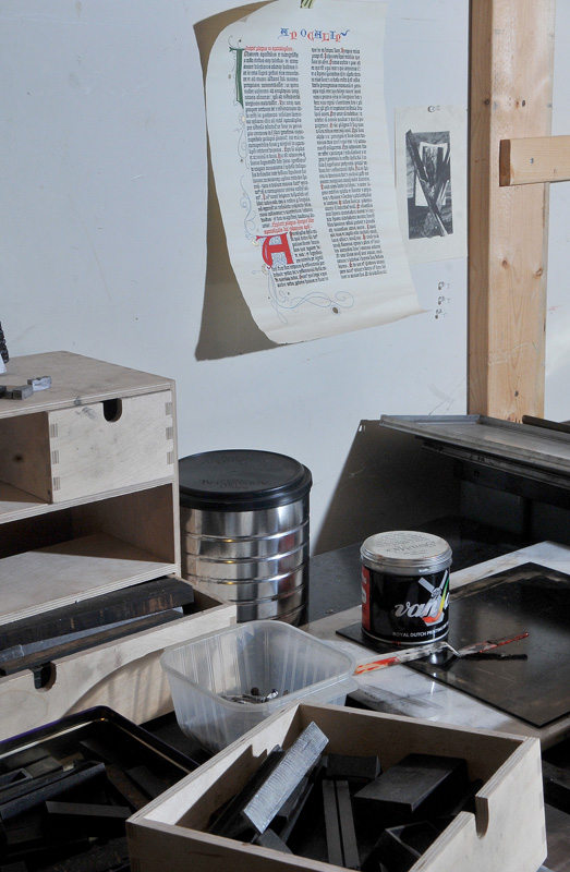 MARIO BARTEL/THE TRI-CITY NEWS The work station in Markus Fahrner's Port Moody garage, where he painstakingly creates pages and posters with individually cast metal fonts for printing in his 1914 Colt Armoury letterpress. A one-page project that could be completed in a couple of hours on a computer can take days.