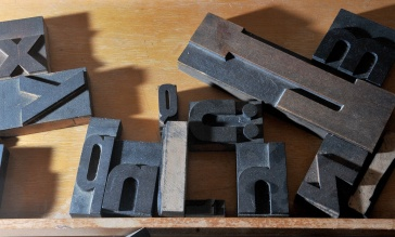 MARIO BARTEL/THE TRI-CITY NEWS Letterpress printing requires the careful placement of individual letters cut into metal blocks into a frame, or chase.