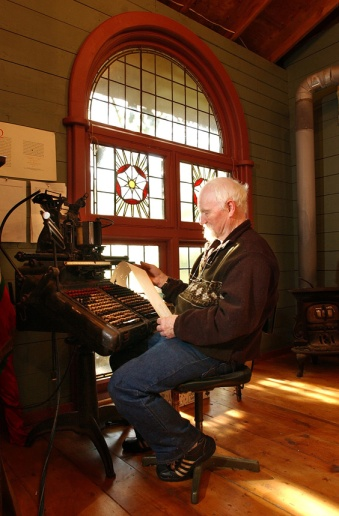 MARIO BARTEL/THE TRI-CITY NEWS The late Jim Rimmer at work on one his vintage typesetters in the studio of his New Westminster home in 2004. Rimmer was a world-renowned typographer who salvaged and restored old printing press machinery and then used them to create fonts and print limited edition posters and books that were coveted by collectors.