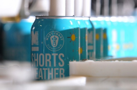 MARIO BARTEL/THE TRI-CITY NEWS Cans of Shorts Weather ISA, one of two new beers brewed by Moody Ales in collaboration with West Coast Canning, are filled on a portable canning machine on Monday.