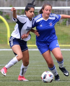 MARIO BARTEL/THE TRI-CITY NEWS Centennial Centaurs forward Jessica Carravatta tries to gain an advantage of Fleetwood Park Dragons defender Niki Virk.