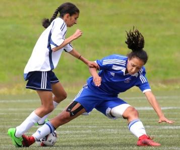 MARIO BARTEL/THE TRI-CITY NEWS Centennial Centaurs forward Sophia Ferreira is knocked off the ball by Fleetwood Park Dragons defender Parveen Braich.
