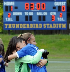 MARIO BARTEL/THE TRI-CITY NEWS Centennial Centaurs goalkeeper Kelsey Eckert and Matisse Jones embrace as they celebrate their team's dramatic 1-0 overtime win over Fleetwood Park secondary school in the BC High School AAA senior girls soccer championship, Friday at UBC's Thunderbird Stadium.