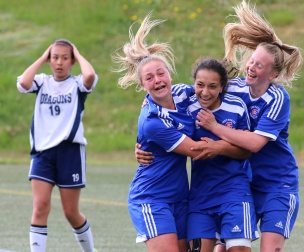 MARIO BARTEL/THE TRI-CITY NEWS Centennial Centaurs forward Sophia Ferreira, centre, is hugged by teammates after she scored the winning goal in their 1-0 win over the Fleetwood Park Dragons in Friday's BC High School AAA senior girls soccer championship at the University of British Columbia's Thunderbird Stadium.