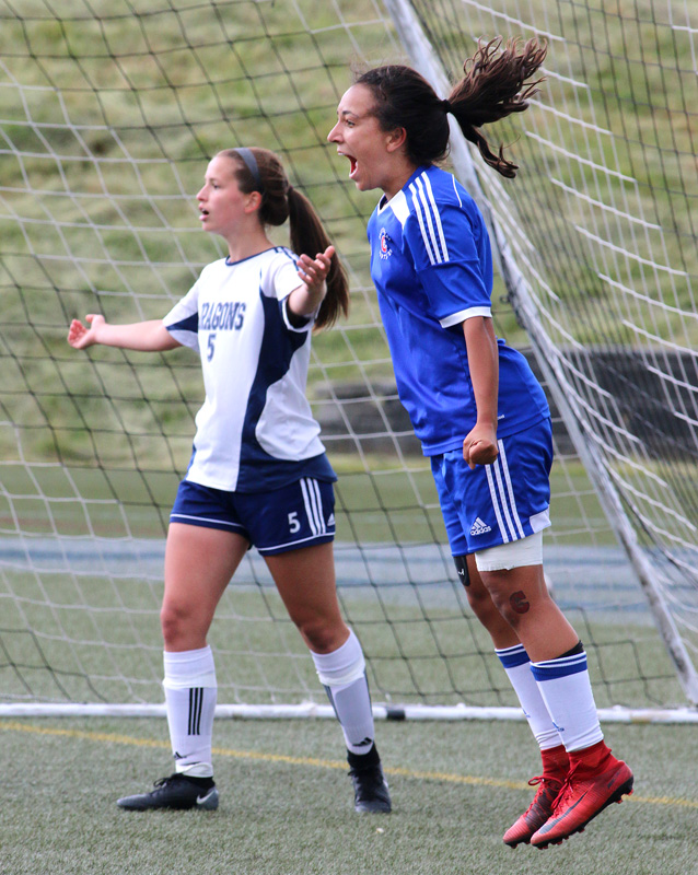 MARIO BARTEL/THE TRI-CITY NEWS Centennial Centaurs forward Sophia Ferreira celebrates her overtime game-winning goal as Fleetwood Park Dragons defender Jenieva Musico protests in disbelief in Friday's BC High School AAA senior girls soccer championship at the Univeristy of British Columbia's Thunderbird Stadium.