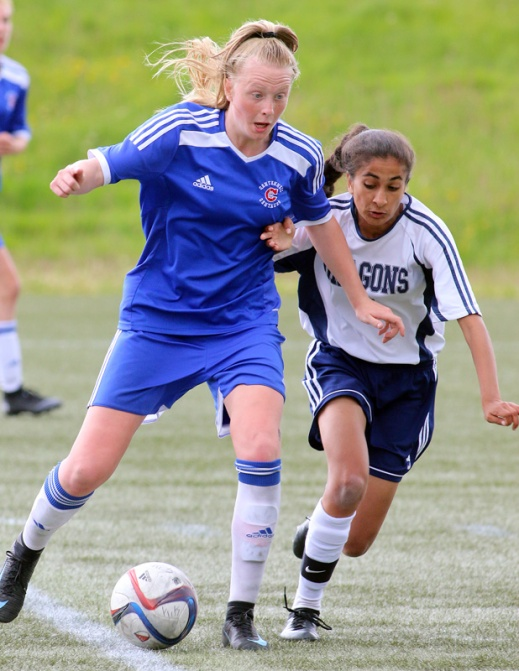 MARIO BARTEL/THE TRI-CITY NEWS Centennial Centaurs forward Raegan Mackenzie works her way around Fleetwood Park Dragons defender Priya Uppal late in the second overtime half of their BC High School AAA senior girls soccer championship, Friday at the University of British Columbia's Thunderbird Stadium. Centennial won the match, 1-0.
