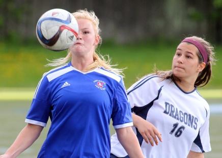 MARIO BARTEL/THE TRI-CITY NEWS Centennial Centaurs' Jessa Vance battles Fleetwood Park Dragons' Sarah Tortora for control of a header.