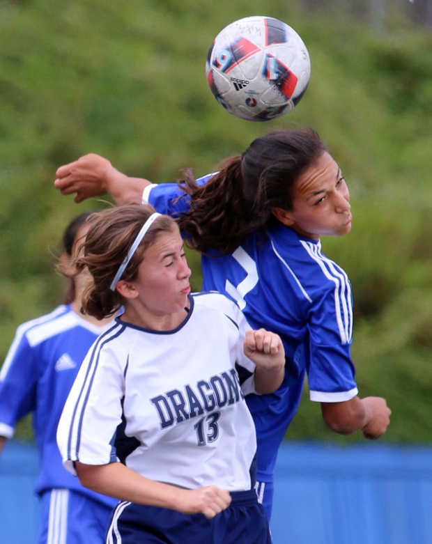 MARIO BARTEL/THE TRI-CITY NEWS Centennial Centaurs forward Sophia Ferreira wins a header from Fleetwood Park Dragons' Mackenzie Fox.