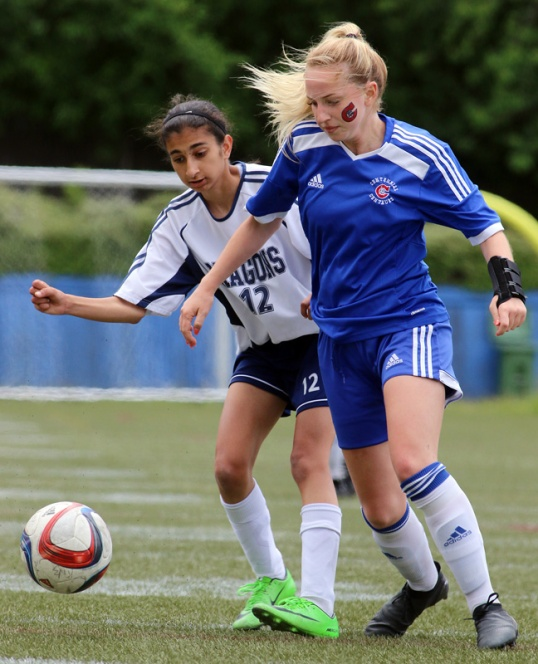 MARIO BARTEL/THE TRI-CITY NEWS Centennial Centaurs midfielder Danae Robillard works her way around Fleetwood Park Dragons defender Harjot Uppal.