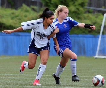 MARIO BARTEL/THE TRI-CITY NEWS Centennial Centaurs midfielder Danae Robillard clashes with Fleetwood Park Dragons defender Sarah Tortora.