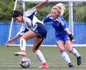 MARIO BARTEL/THE TRI-CITY NEWS Centennial Centaurs midfielder Danae Robillard clashes with Fleetwood Park Dragons defender Sarah Tortora.