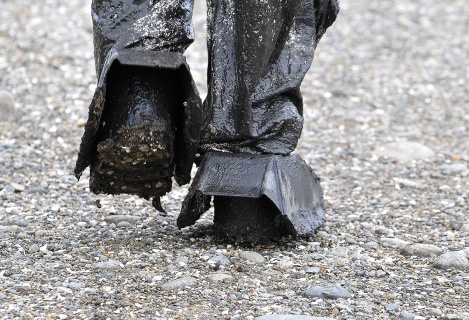 MARIO BARTEL/THE TRI-CITY NEWS It's a dirty job getting people out of the mudflats if they become stuck.