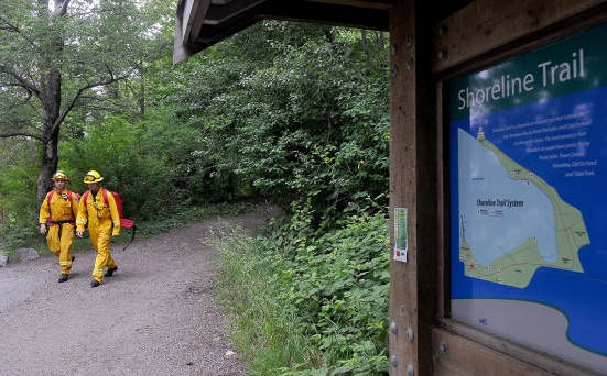 MARIO BARTEL/THE TRI-CITY NEWS Firefighters wearing backpacks containing specialized equipment walk towards the mudflats at the eastern end of Port Moody Inlet to practise rescuing a colleague who's been sucked into the thick, heavy muck at low tide. Port Moody fire chief Ron Coulson says the easy access to the flats from nearby trails makes them alluring to visitors who may not know what they're getting themselves into.