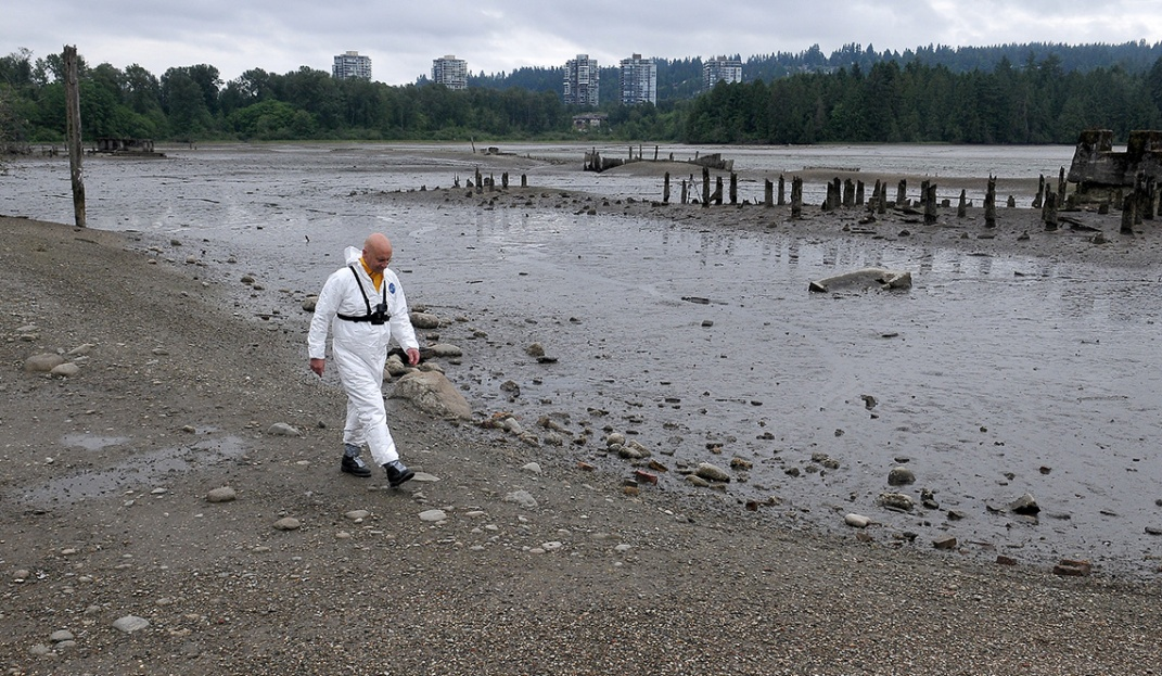 "MARIO BARTEL/THE TRI-CITY NEWS The designated ""victim"" for the exercise, Port Moody fire captain Ron Suzukovich, walks toward his doom in the mudflats off the Old Mill site on the north shore of Port Moody Inlet. Fire chief Ron Coulson says the easy access to the flats from shoreline trails and the proximity of many residents means his crews usually get called out twice a year to pluck people from the heavy muck."