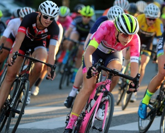 MARIO BARTEL/THE TRI-CITY NEWS The pro women's race sets off in twilight.
