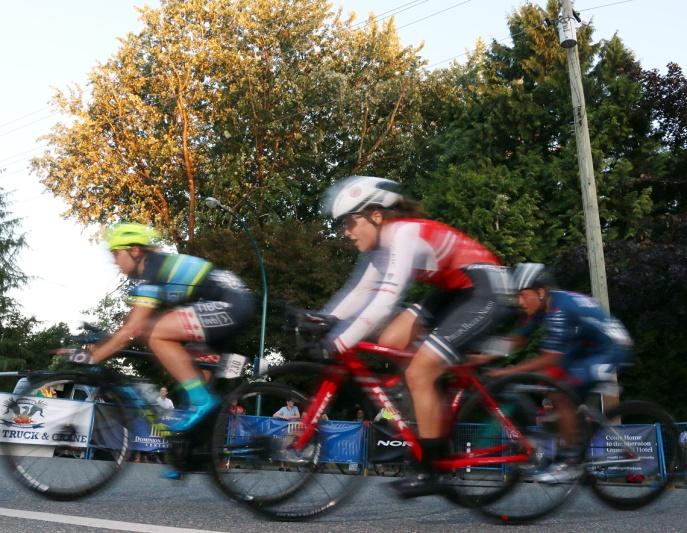 MARIO BARTEL/THE TRI-CITY NEWS The women round a corner in fading daylight at Friday's Poco Grand Prix.